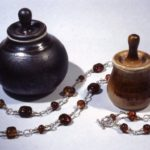 Porcelain jars with lamp work glass bead necklace