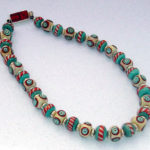 Lampwork glass beads with vintage bakelite domino clasp