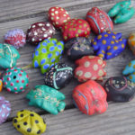 "Hollow formed soda lime glass ""amoeba"" beads."